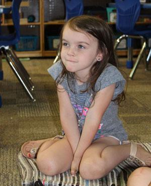 girl asks question of kindergartner
