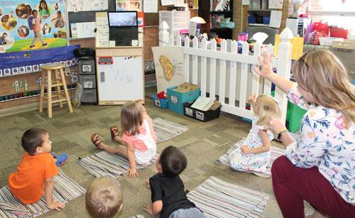 preschoolers  wave goodbye to kindergartners