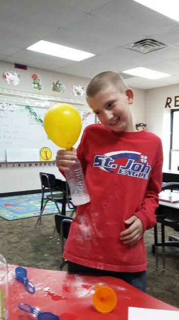Malachi making a Pop Bottle Rocket