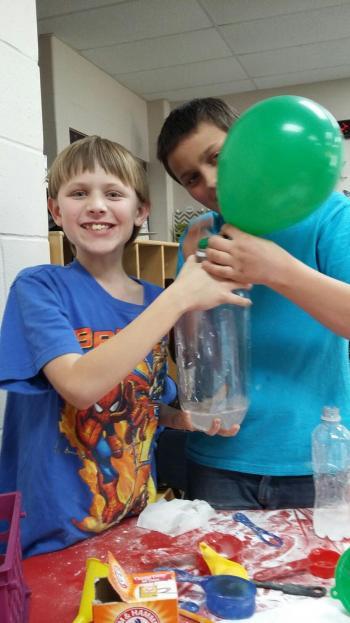 Trenton and Dylan making Pop Bottle Rockets