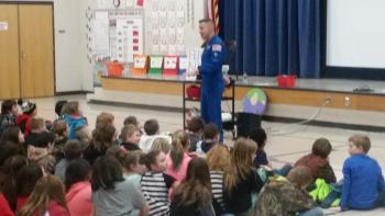 Astronaut teaching students