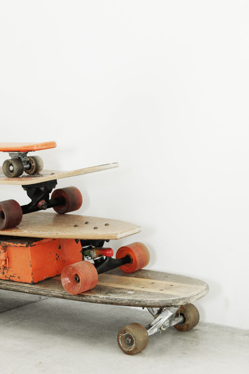 Vintage skateboards with colorful wheels make a graphic retro statement against a white wall in a room designed by Leanne Ford. #skateboard #edgy #bohochic #leanneford