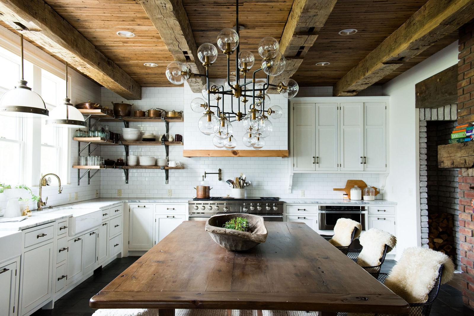 Leanne Ford kitchen with modern farmhouse style, Sputnik chandelier, white cabinets, subway tile, and rustic decor.