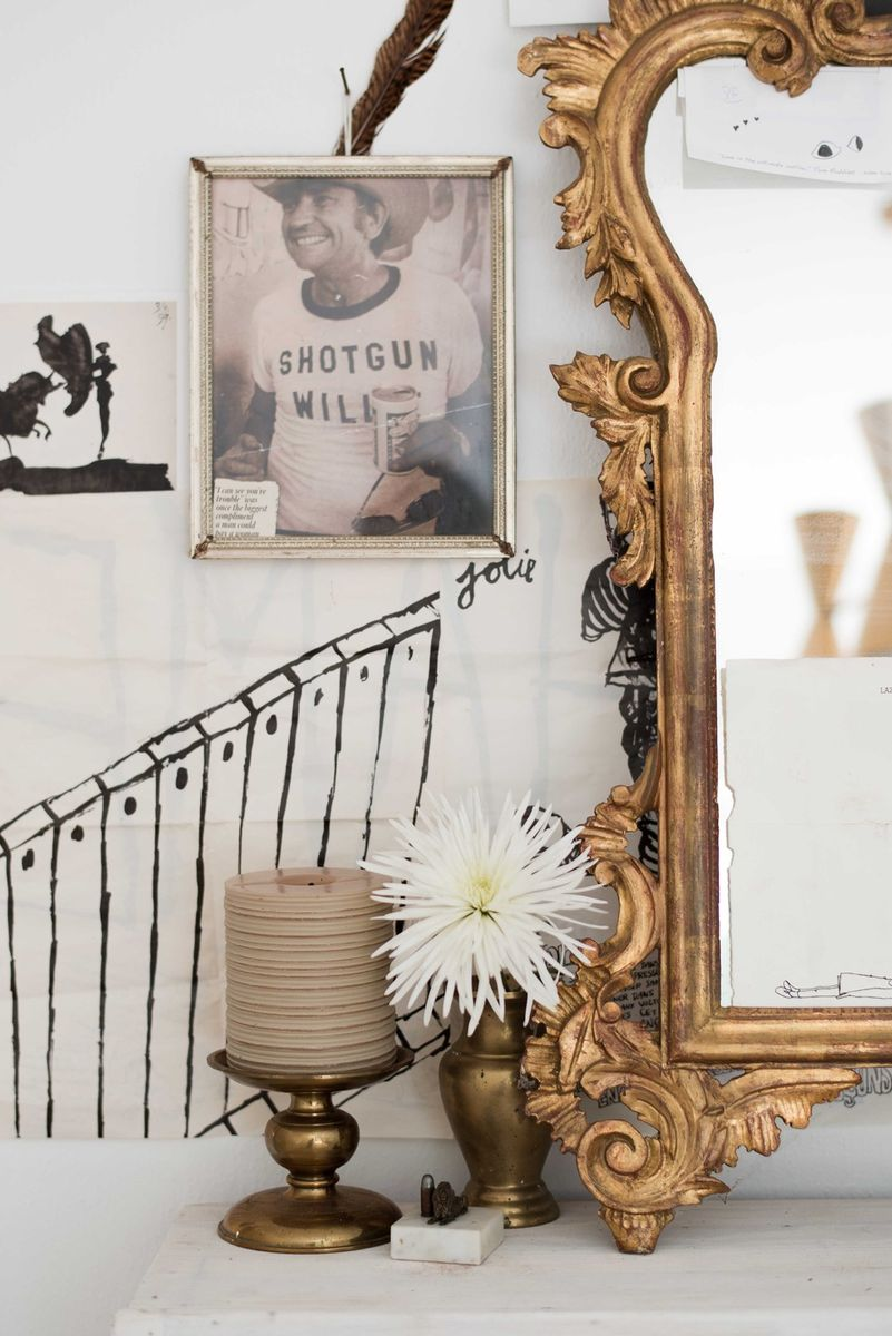 Bohemian decor in a vignette styled by Leanne Ford. #blackandwhite #bohemian #decorinspiration #leanneford #rusticdecor #vintagestyle