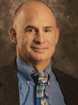Titus   Plomaritis, MD Independent Medical Examiner
