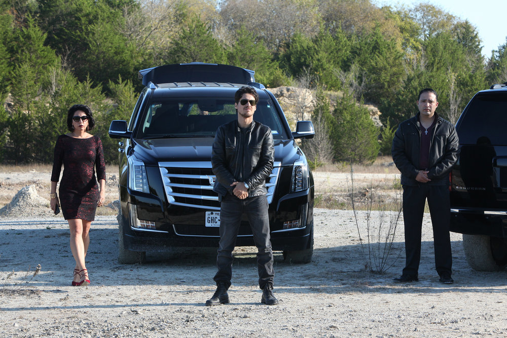 "QUEEN OF THE SOUTH -- ""Lirio de lo Valles"" Episode 104 -- Pictured:  (l-r) Veronica Falcon as Camila Vargas, Peter Gadiot as James Valdez -- (Photo by: Bill Matlock/USA Network)"