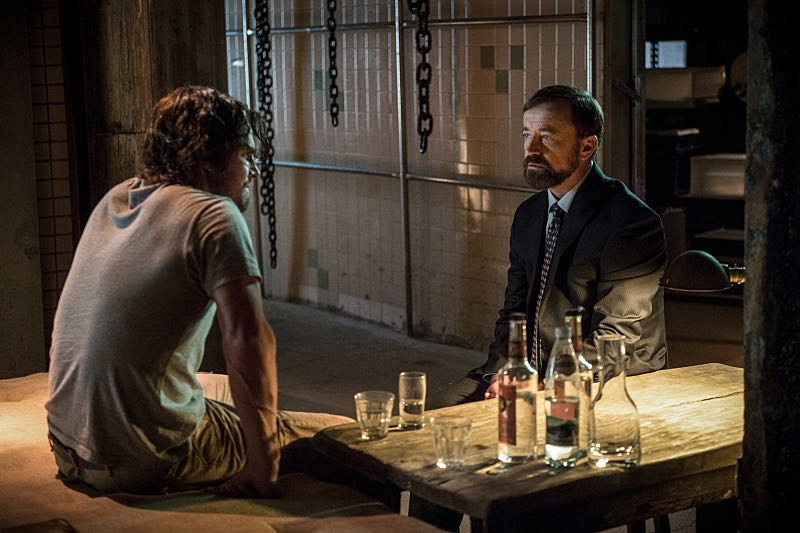 """Arrow -- """"A Matter Of Trust"""" -- Image AR503B_0014b.jpg --- Pictured (L-R): Stephen Amell as Oliver Queen and David Nykl as Anatoly Knyazev -- Photo: Diyah Pera/The CW -- © 2016 The CW Network, LLC. All Rights."""
