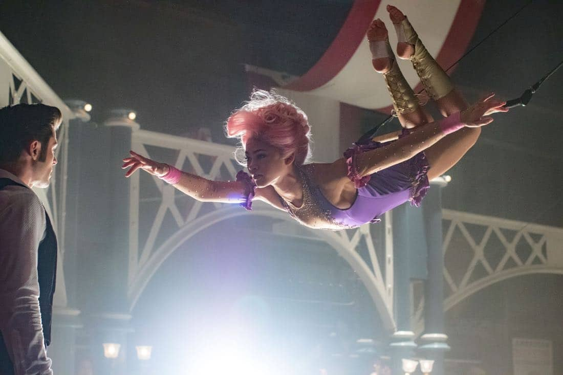 Philip (Zac Efron) is entranced by Anne's (Zendaya) trapeze artistry in Twentieth Century Fox's THE GREATEST SHOWMAN.