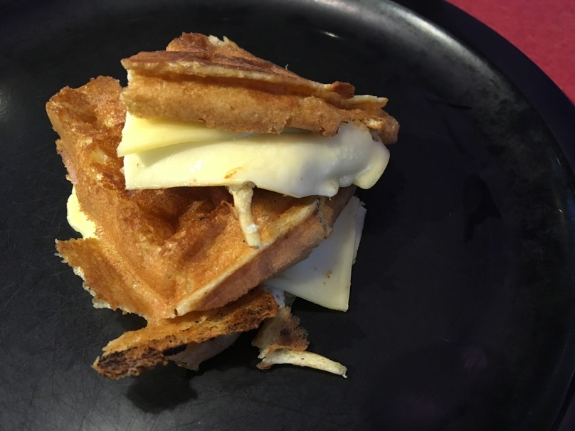 egg, waffle, bacon, syrup, cheese, toast, cinnamon, maple syrup