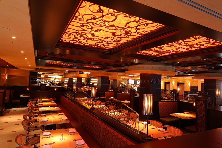 The Real Reason The Cheesecake Factory Keeps The Lighting