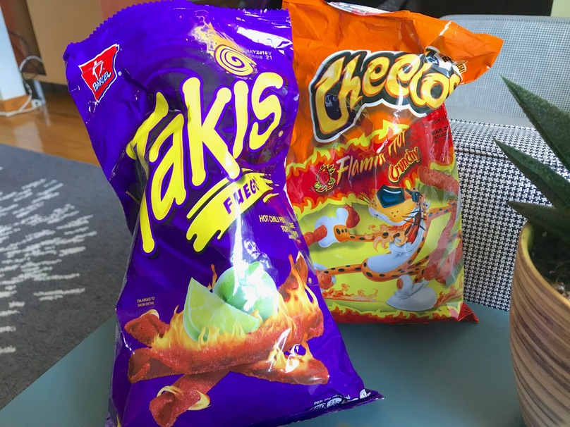 Flamin' Hot Cheetos Vs. Takis: Which One Is For You?