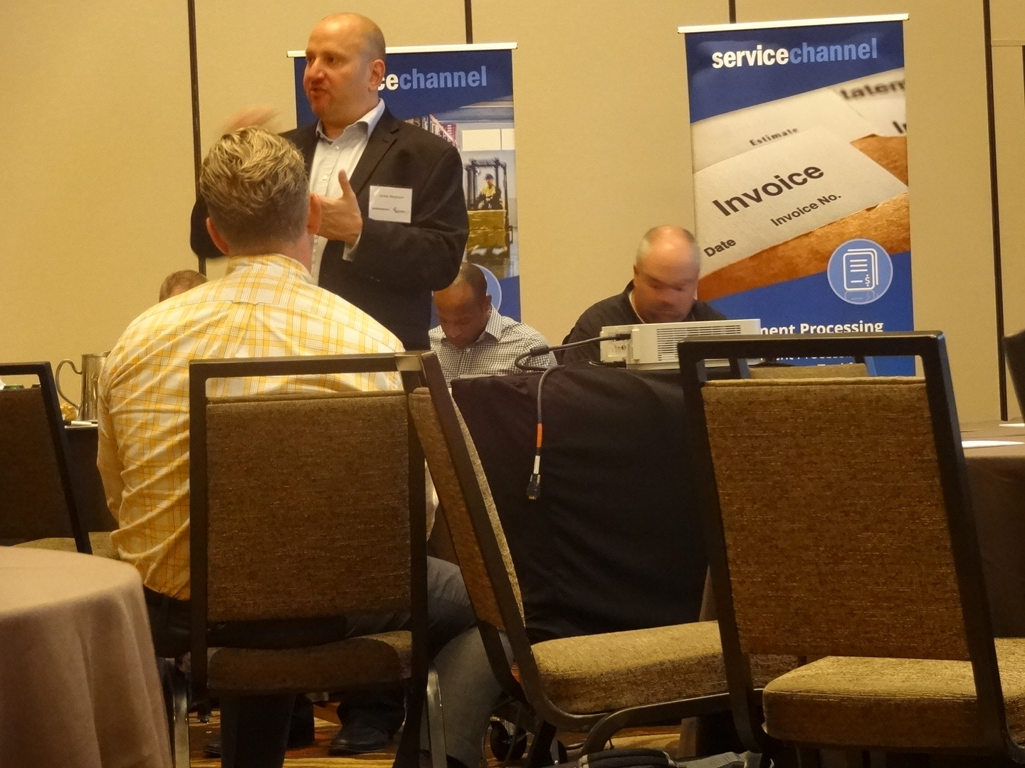 Jordan Bergtram, VP Product Mgmt, discussing FM software with ServiceChannel clients