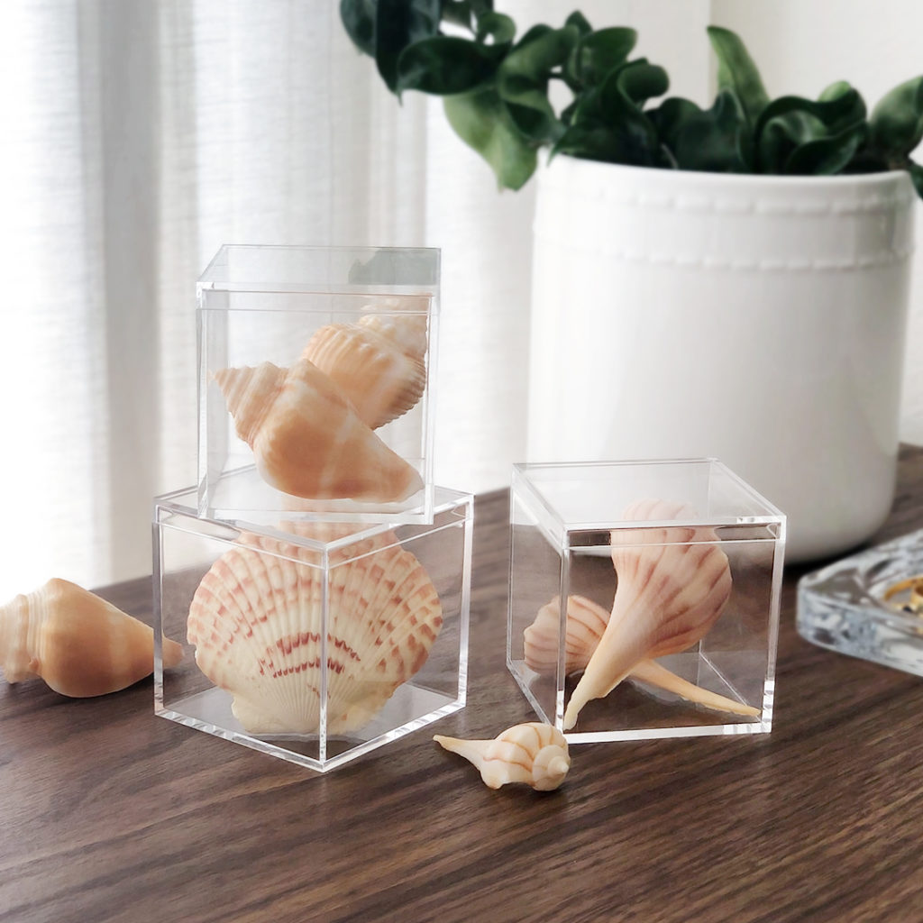 urn souvenirs from your travels into display objects for your home. Fill Candy Cubes with shells, coins, pebbles, buttons, or anything else you pick up on vacation; when they're styled on a shelf, they'll look like intentional pieces of art.