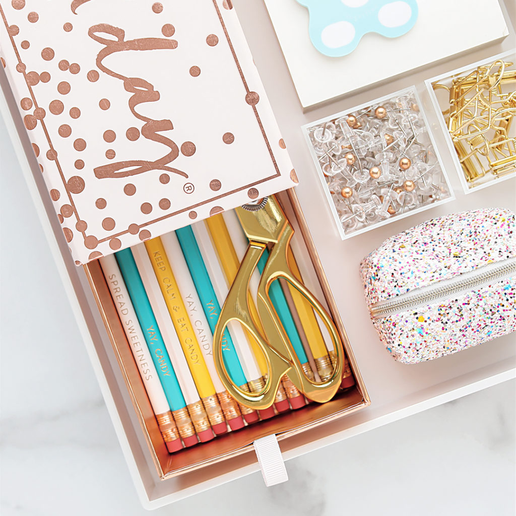 A Candy Cube will be your home office's new best friend: Store paper clips, push pins, sticky notes, and binder clips each in their own little box. Best of all? They're stackable!