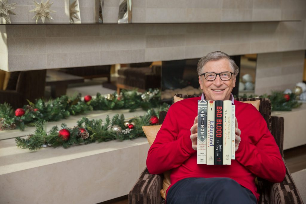 329d4e72a2 Bill Gates with his five recommended holiday reads. Photo  Gates Notes