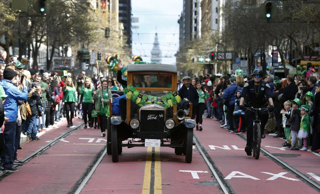 b777005b1 A large crowd lines both sides of Market Street to watch the 2018 St. Patrick's  Day Parade in San Francisco. Photo: Paul Chinn, The Chronicle 2018