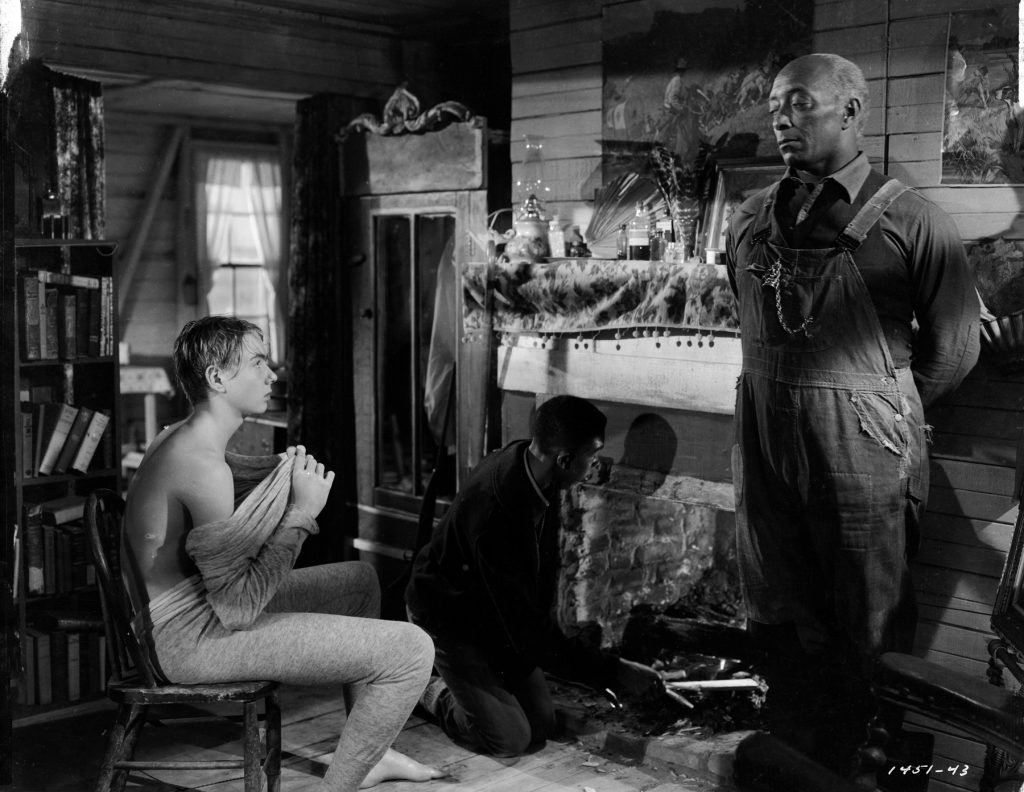 """f211e7bd4c2 Claude Jarman Jr. (left) and Juano Hernandez in Clarence Brown s 1949  adaptation of William Faulkner s """"Intruder in the Dust."""" Photo  MGM 1949"""