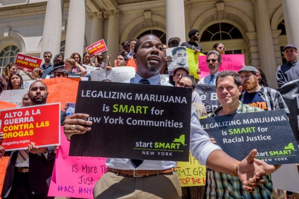 CITY HALL STEPS, NEW YORK, UNITED STATES - 2018/06/20: Chris Alexander, policy coordinator, Drug Policy Alliance - Advocates, community organizations, and Council Members held a press conference and rally at the steps of City Hall, challenging Mayor de Blasio and the NYPDs newly-announced marijuana enforcement policy, urging the Mayor to end racially biased marijuana arrests completely. The Mayor and NYPD Commissioner announced the policy shift yesterday in the culmination of their 30-day review period to assess marijuana enforcement in NYC. (Photo by Erik McGregor/Pacific Press/LightRocket via Getty Images)