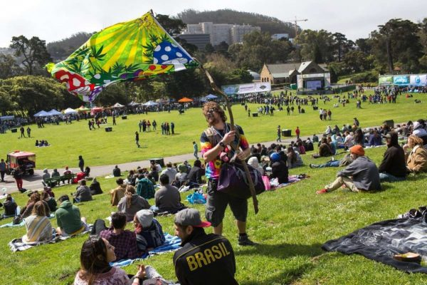 Kelly Jensen holds a flag while he makes his way through the crowd offering goods for sale during the annual 420 in the Park pot festival at Hippie Hill in Golden Gate Park. Saturday, April 20, 2019. San Francisco, Calif.Photo: Jana Asenbrennerova / Special to The Chronicle