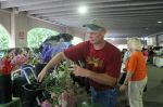 Restocking flowers at the Iowa City Farmers Market