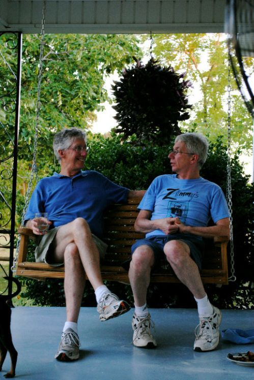 Stuart and his brother, David, on the porch of The Lodge overlooking the pond.
