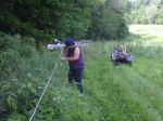 Moving the portable fence for new pasture / Nida