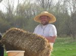 Farmer Andy getting ready to spread some hay.