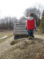 The farm gets a fresh load of gravel and makes one little boy very happy.