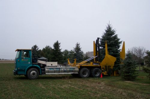 planting a 16' blue spruce, Pemberville Ohio