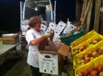 Kathy inspecting apples before putting them in boxes...