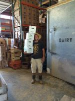 Matt putting freshly picked boxes of sorrel into the cooler