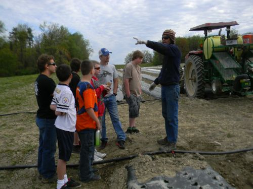 Mike with kids from the Yellow Breeches Educational Center in the field