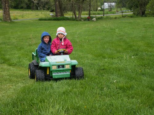 Office Manager Jamie's son, Evan, and Farmer Mike's daughter, Sage, riding around in the toy gator 5/13/13