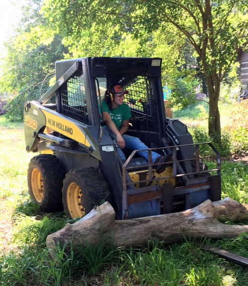 Erica manning the skid steer