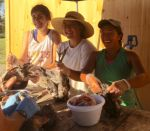 Apprentice Suzie,with interns Yukka and Molly butchering Chickens