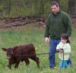 Erick & our daughter Lexi walking her calf, 'Abigail'