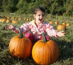 our daughter Lexi in our pumpkin patch