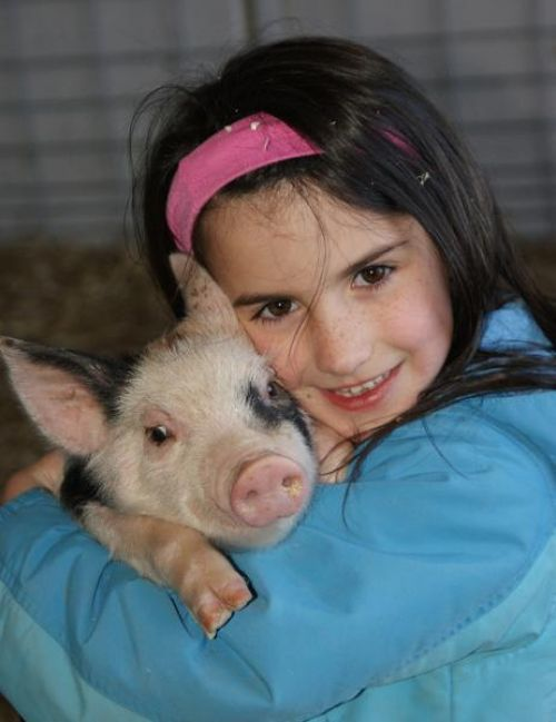 Lexi with a piglet