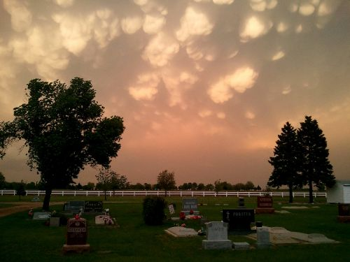 "We live in a beautiful area, and storms make for interesting cloud formations. We call these ""angel butts"""
