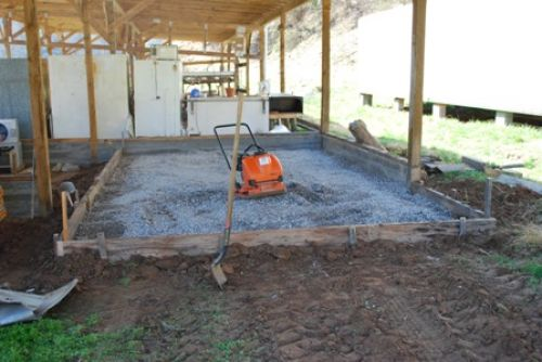 tamping gravel for new walk in cooler