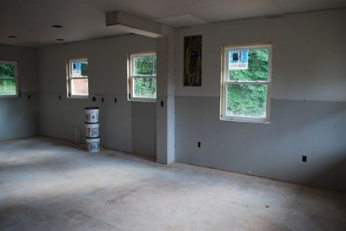 Great room and kitchen wall with drywall hung