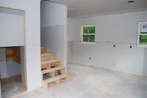 kitchen and stairwell with drywall