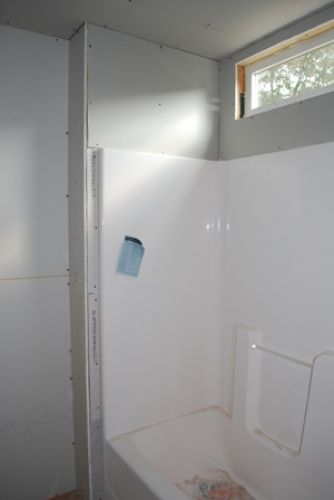 bathroom with drywall hung