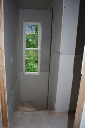 Stairway from upstairs with drywall hung
