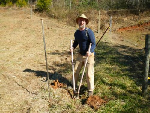 Jason digging a hole for a new deer fence