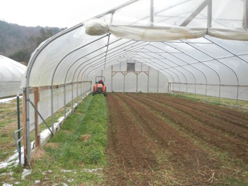 Jason preparing the hoop house beds for planting