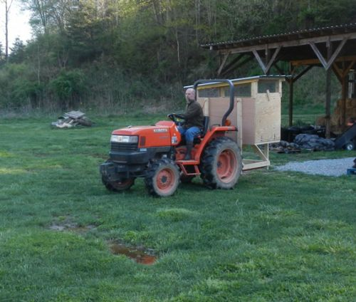 Jason moves the chicken house out to pasture