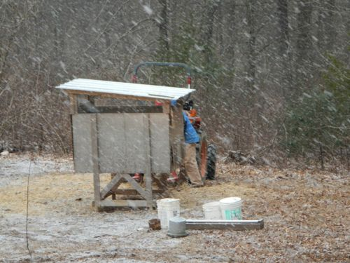 Jason moving the chicken hut to shelter just as th