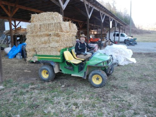 Jason hauling a giant load of straw in the gator