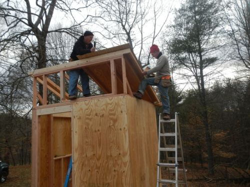Jason and Lee building a cabin